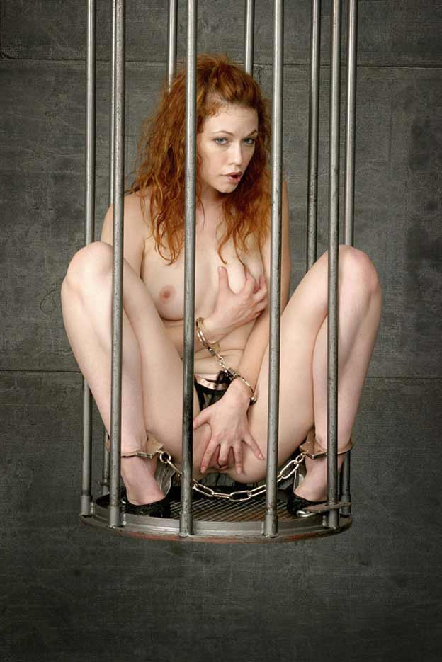 Caged bdsm sub gets cock tugged outdoors 2